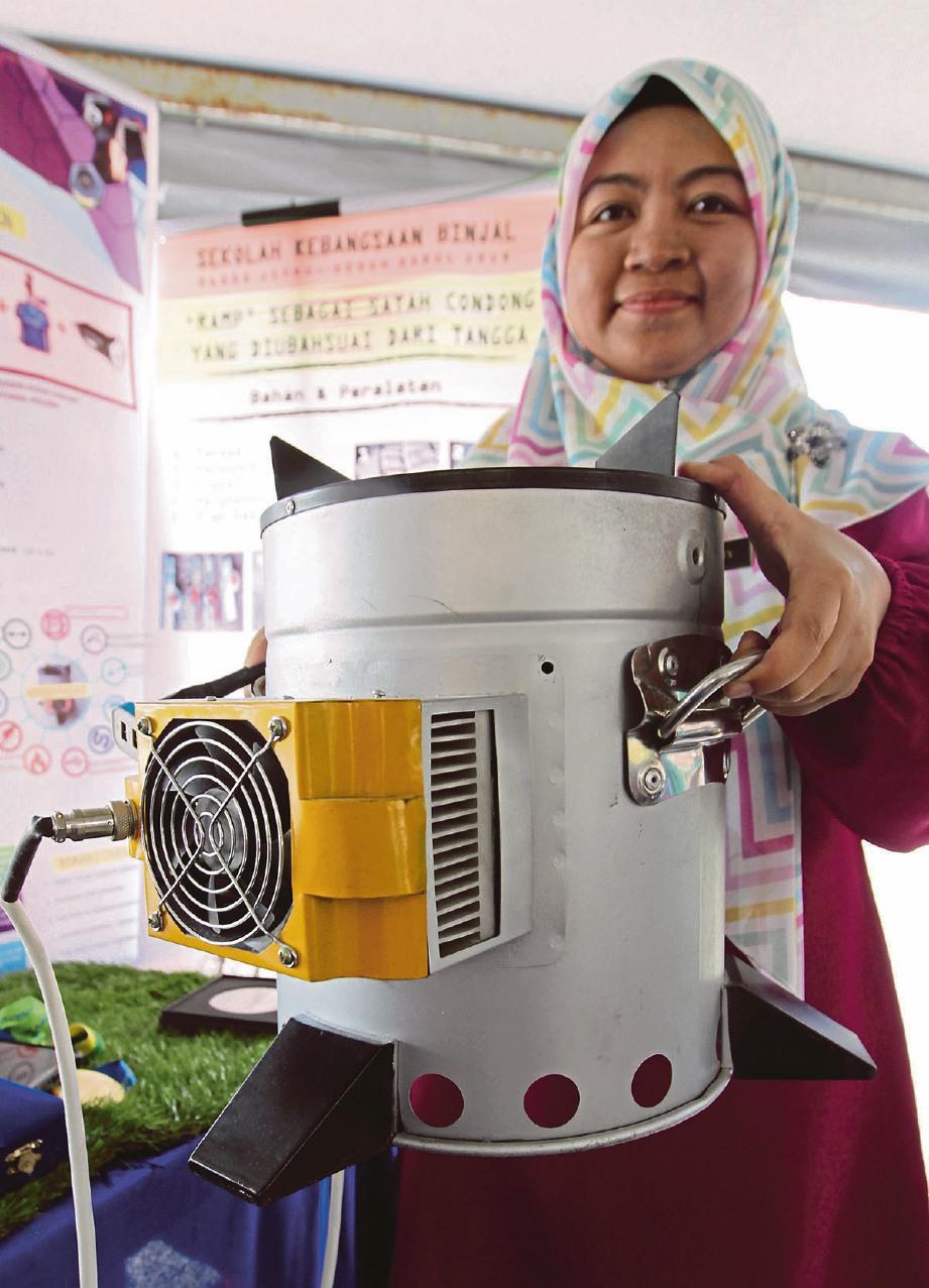 INOVASI peralatan Smart Camping Stove yang dihasilkan Sekolah Kebangsaan Binjal, Alor Setar, Kedah. FOTO Sharul Hafiz Zam