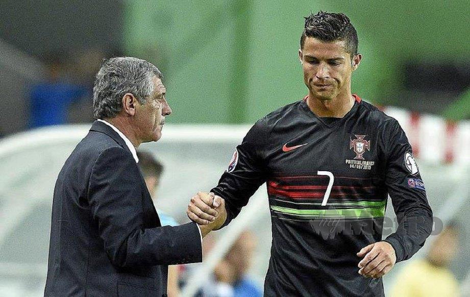 Santos (kiri) tagih khidmat Ronaldo di jentera serangan.
