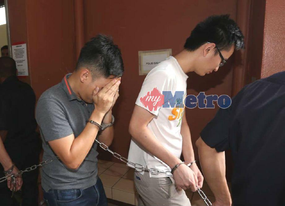 DUA lelaki didakwa di Mahkamah Sesyen Taiping atas tuduhan menerima wang deposit pelaburan tanpa lesen sah di sebuah sekolah kira-kira dua tahun lalu. Foto NSTP/MUHAIZAN YAHYA