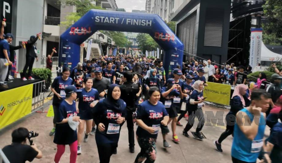 Peserta menyertai acara larian Mega Maju New Generation Run.