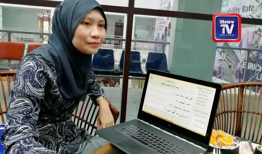 DR Unaizah Hanum menunjukkan fungsi dan cara penggunaan aplikasi. FOTO NSTP