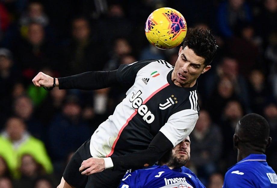 AKSI Cristiano Ronaldo ketika perlawanan Sampdoria menentang Juventus. FOTO AFP