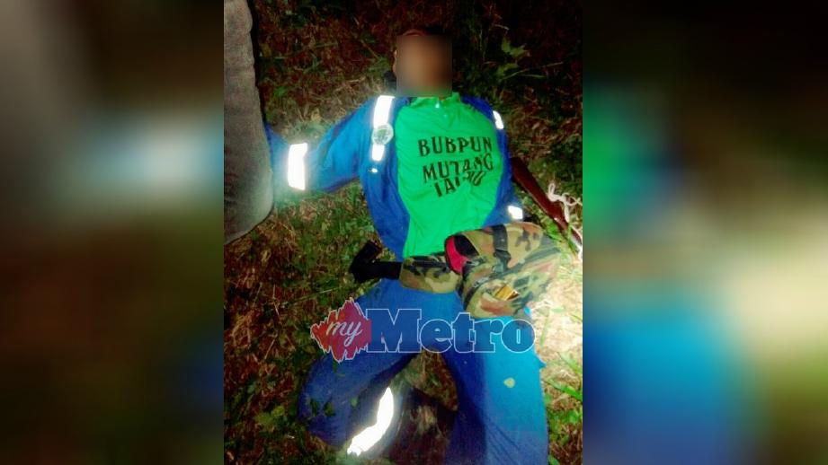 LELAKI maut selepas terkena ditembak pemburu dengan 'bekakok' di ladang kelapa sawit di Jalan Samling, Lawas. FOTO ihsan polis.