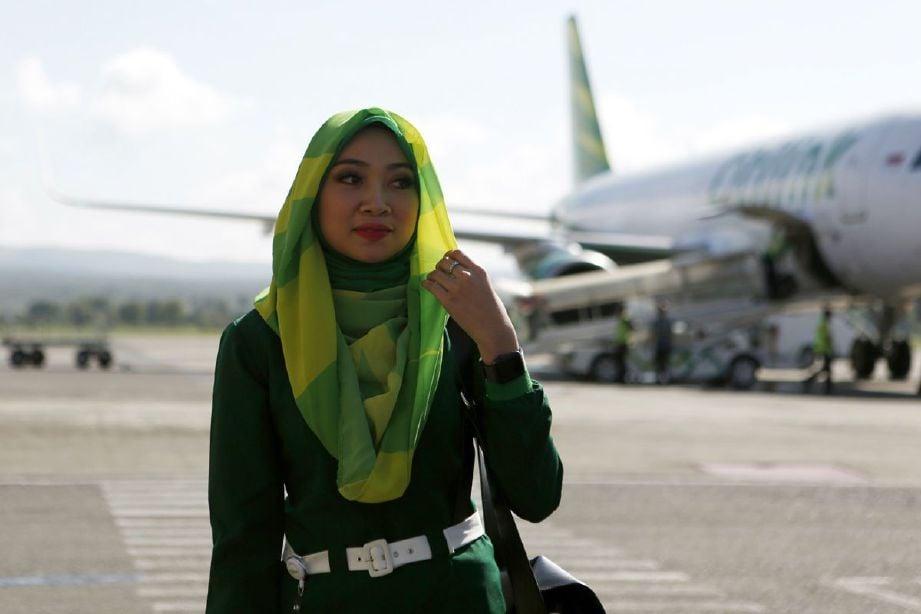 Pramugari penerbangan yang tiba di Banda Aceh, hari  ini. FOTO EPA