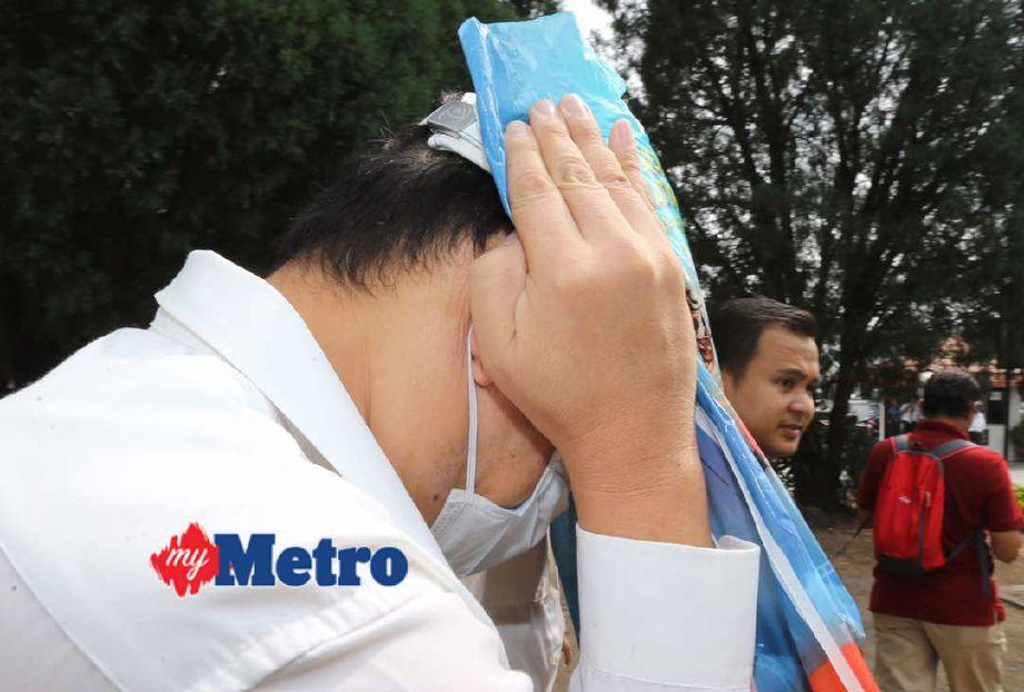 Lim didenda RM10,000 oleh Mahkamah Majistret Ipoh selepas mengaku bersalah terhadap lapan tuduhan merakam aksi lapan mangsa yang mandi di inap desa. FOTO Muhaizan Yahya