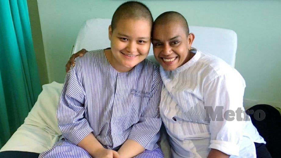 BAMIMI (kanan) bersama Richelle yang disahkan mengidap kanser. FOTO IHSAN UMS