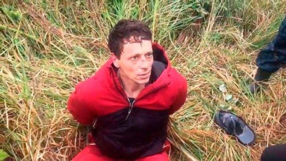 MOLCHANOV ketika ditahan polis selepas membunuh dan merogol anak teman wanitanya. FOTO AGENSI