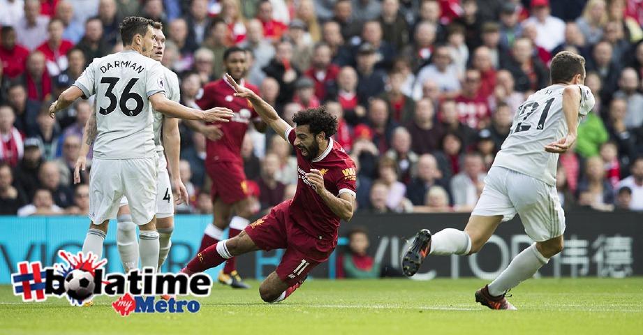 AKSI United ketika menentang Liverpool. -Foto AFP