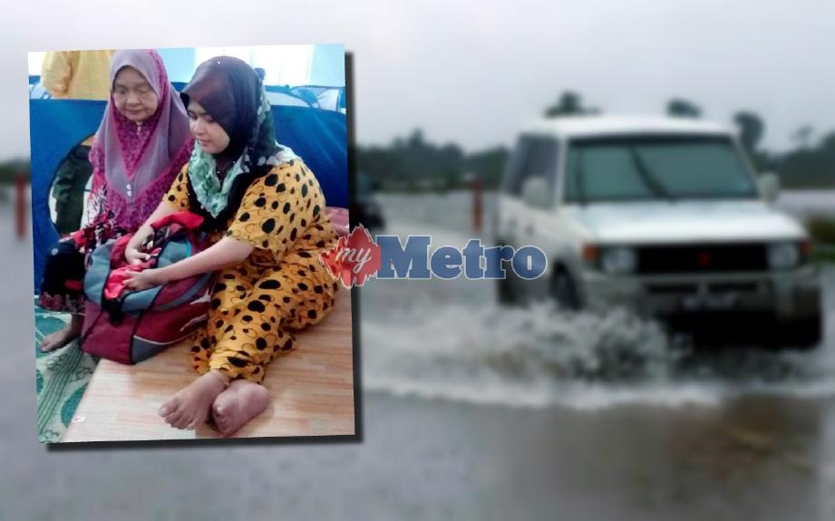 Zauyah (kanan) bersama emaknya, Fatimah mengemas beg pakaian mereka di PPS ekoran keadaan air naik terlalu cepat di Kampung Ana. FOTO Mohamad Zulhairie Manzaidi
