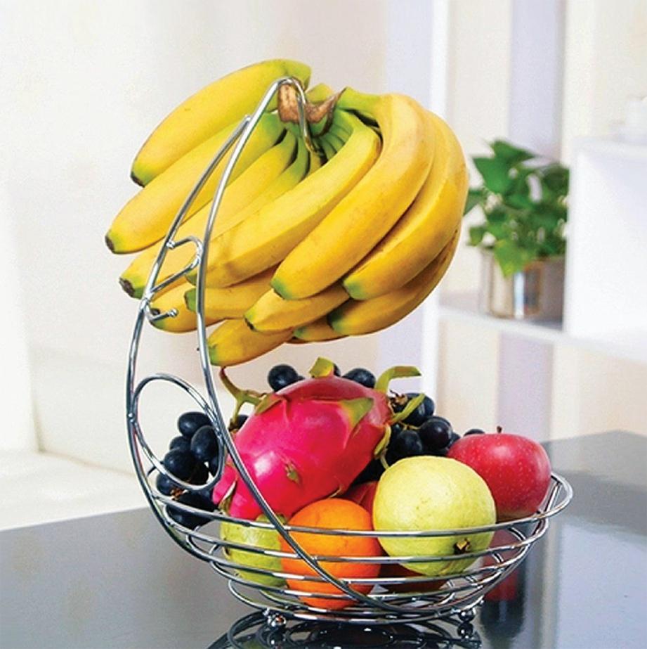 SEMANGKUK buah-buahan dekorasi relevan pada meja makan.