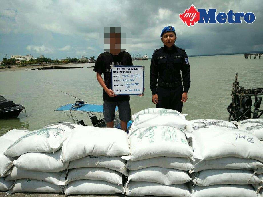 Remaja lelaki berusia 18 tahun (kiri) ditahan bersama 39 kampit beras pulut. FOTO ihsan PPM Tawau