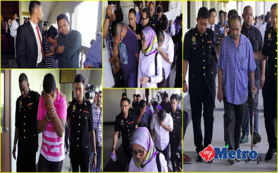 Pegawai dan tujuh anggota polis yang dituduh rasuah di Mahkamah Seksyen Kuala Lumpur, Jalan Sultan Haji Ahmad Shah. FOTO Mohamad Shahril Badri Saali