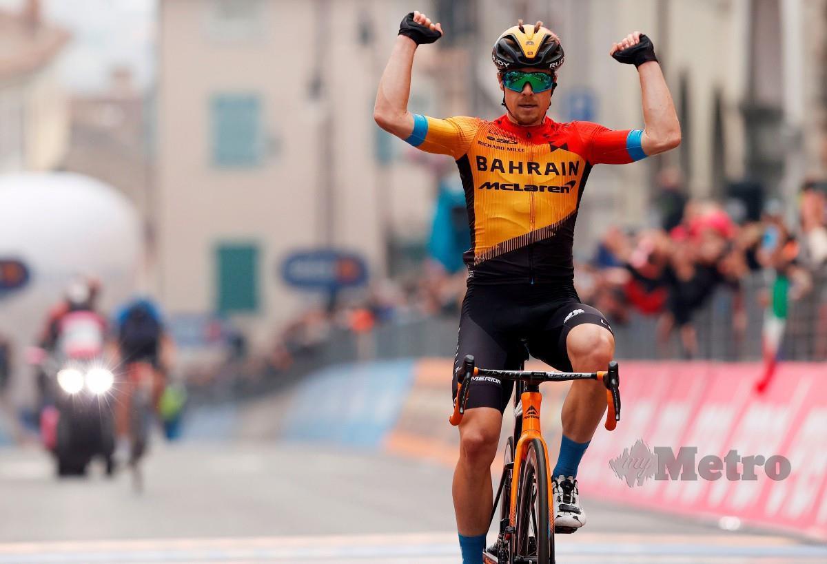 TRATNIK meraikan kejayaannya mengungguli peringkat perlumbaan ke-16. FOTO AFP