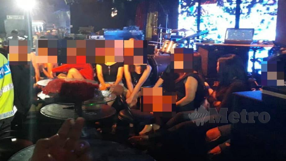 Antara wanita yang diperiksa dalam Op Noda di Taman Usahawan Kepong, Kuala Lumpur malam tadi. Foto Ihsan PDRM