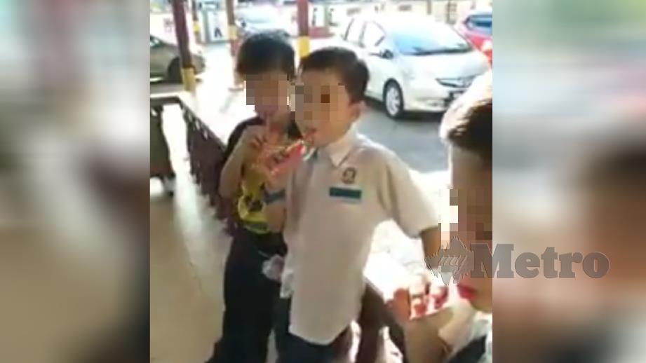 VIDEO tular mengenai gula-gula berasap yang dijual kepada murid di Papar.  FOTO Tular Facebook