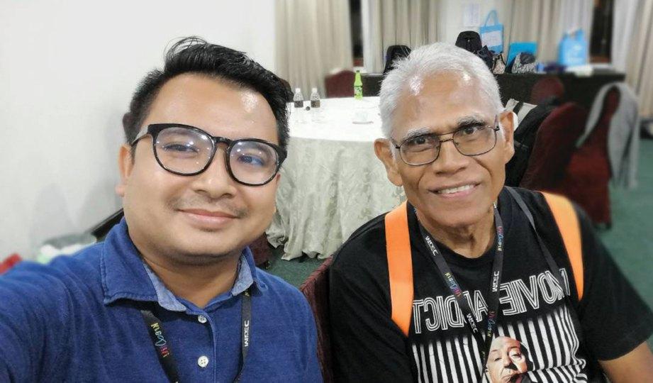 PENULIS bersama Pak Hassan.