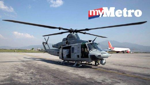 Gambar Helikopter UH-1Y yang dirakam di Lapangan Terbang Antarabangsa Tribhuvan, Kathmandu, Nepal, sebelum ini. FOTO AFP