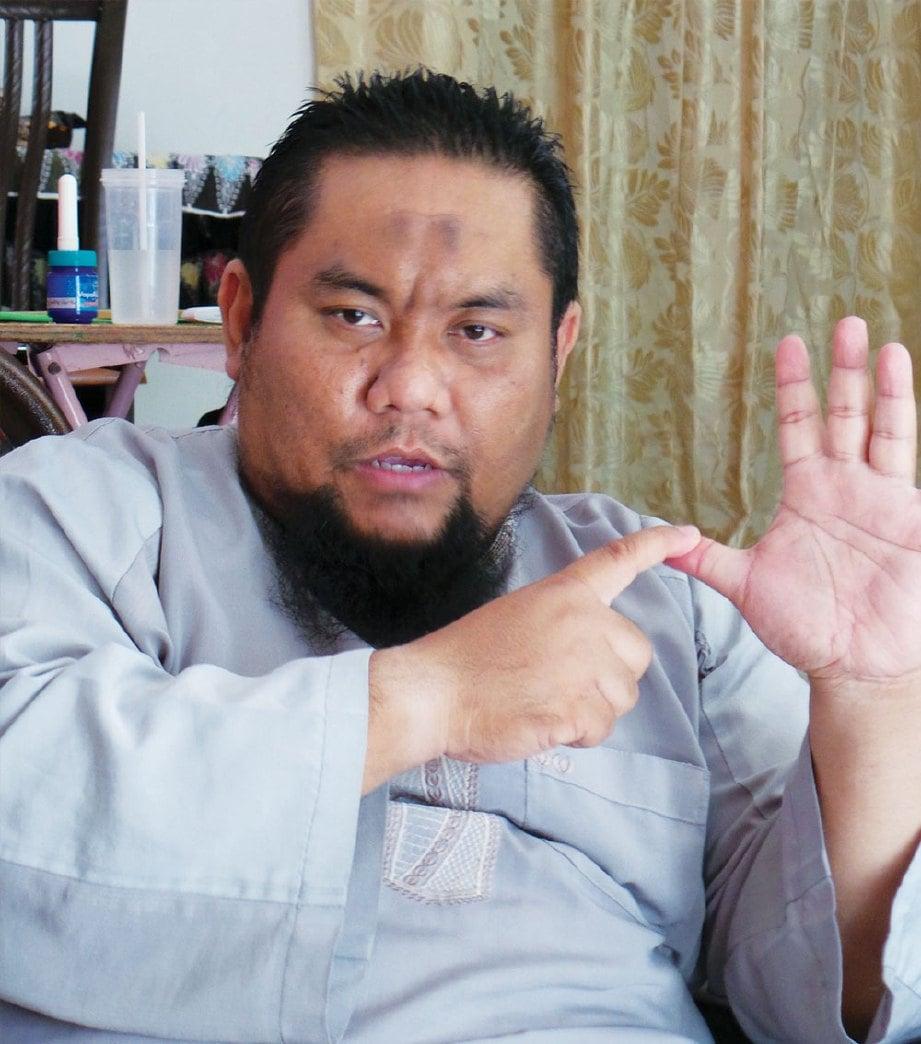 USTAZ Khairul.
