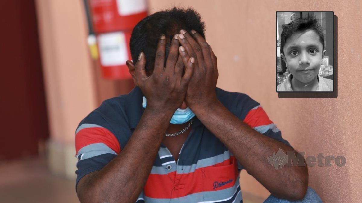 BAPA mangsa tertusuk pisau J Adithiyan,  Jegathesam A/L Mariappan kelihatan sedih berikutan anaknya yang dilaporkan tertusuk pisau dibahagian badan ketika berada di rumah ibu saudaranya. FOTO Sharul Hafiz Zam