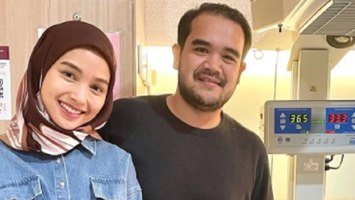 Asyraf Khalid bersama isterinya. FOTO IG