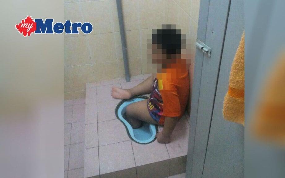 BUDAK lelaki tujuh tahun tahan sakit lebih sejam apabila kaki kirinya tersangkut di dalam lubang tandas rumahnya di Kampung Pasir Tambahan, Batang Kali, hari ini. FOTO ihsan bomba