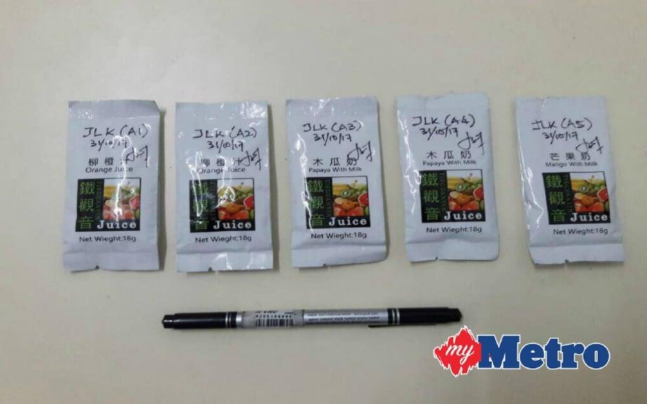 Pek ekstrak jus yang dirampas polis. FOTO Ihsan PDRM