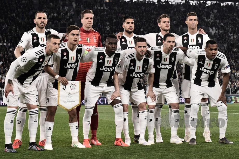 Ronaldo bersama rakan sepasukan Juventus yang memenangi kejuaraan Serie A. FOTO AFP.