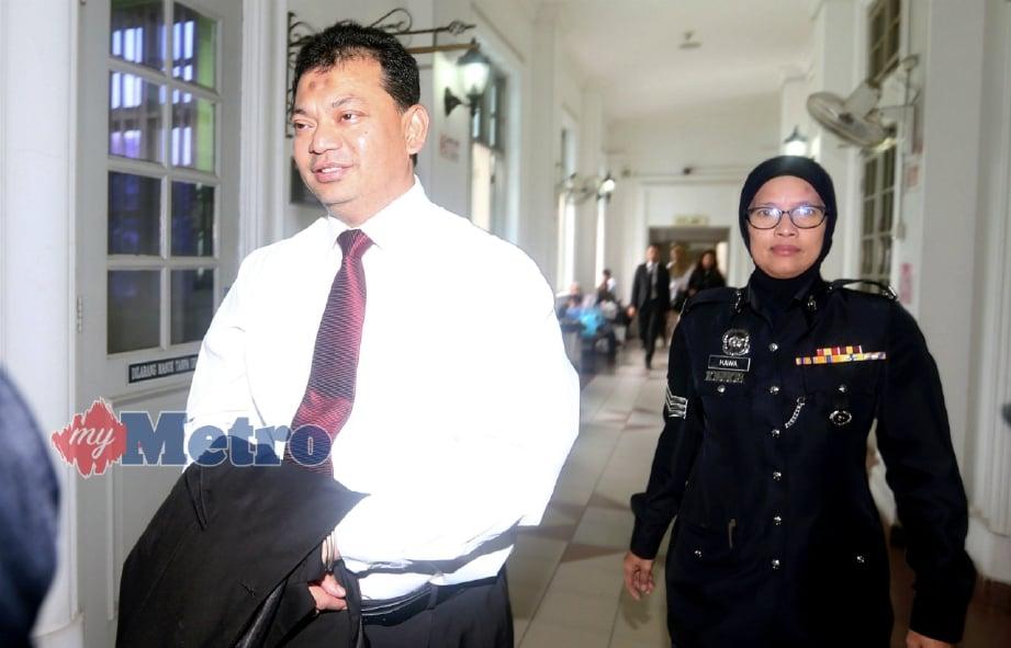 KAMAL ketika hadir di mahkamah, hari ini. FOTO Hairul Anuar Rahim