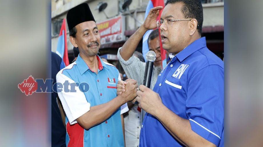 LOKMAN (kanan) dan  Mohd Zawawi. FOTO Arkib NSTP