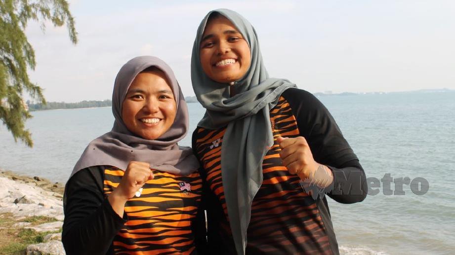 Juni (kanan) dan Nuraisyah layak secara merit ke Sukan Olimpik Tokyo 2020. FOTO MOHD AMIN JALIL