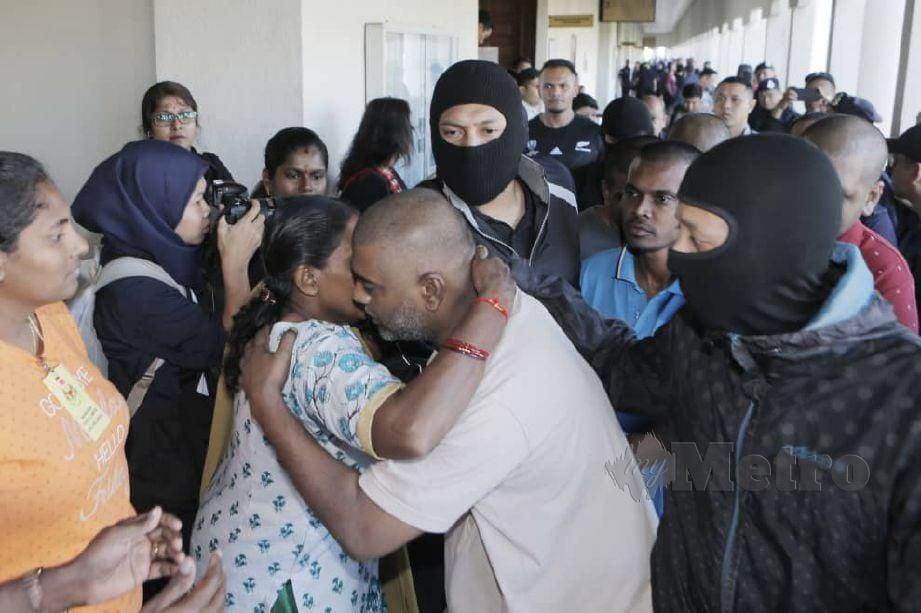 SEBAHAGIAN daripada 12 tertuduh kes LTTE yang hadir di mahkamah, hari ini. FOTO Aizuddin Saad.