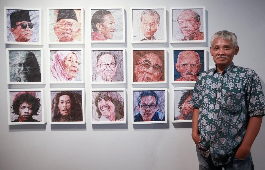 ARIE Kadarisman bersama karyanya bertajuk The Faces. FOTO Sairien Nafis