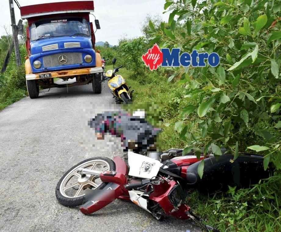 Mangsa maut di tempat kejadian akibat digilis lori tanah. FOTO Rosli Ilham