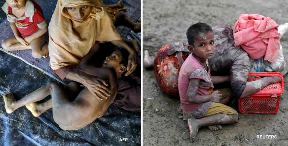 Seorang wanita Rohingya meriba anaknya di bawah khemah tidak sempurna sebaik tiba di Teknaf, Bangladesh.