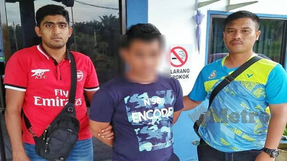 POLIS menahan suspek yang menyamar anggota polis. FOTO Ihsan PDRM