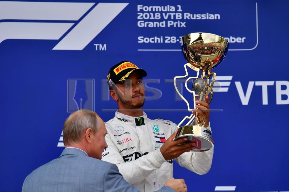 PRESIDEN Russia, Vladimir Putin mengucapkan tahniah kepada Hamilton. FOTO AFP