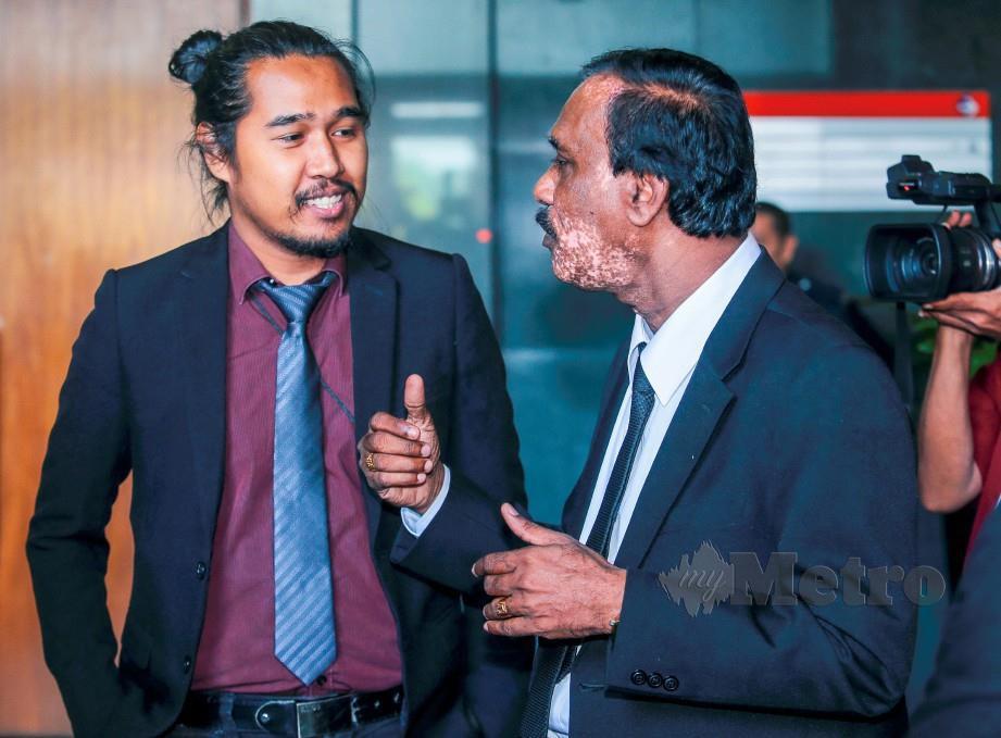 Sayuti (kiri) dan Arulldass pada sesi pendengaran awam RCI hari ini. FOTO Luqman Hakim Zubir
