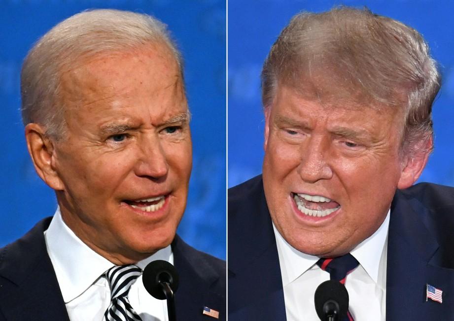 JOE Biden (kiri) dan Donald Trump ketika sesi debat. FOTO AFP