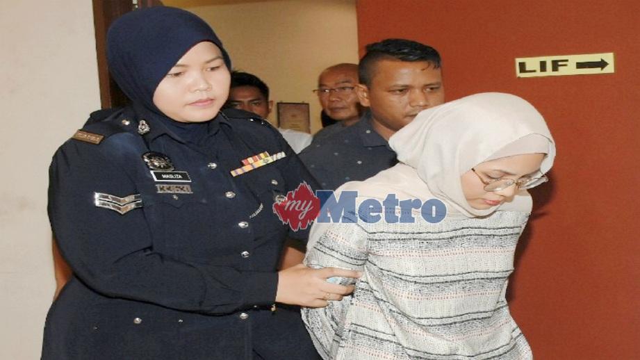 MAYA (kanan) mengaku tidak bersalah atas kesalahan membuat laporan polis palsu di Mahkamah Majistret Shah Alam, hari ini. FOTO Mohd Asri Saifuddin Mamat