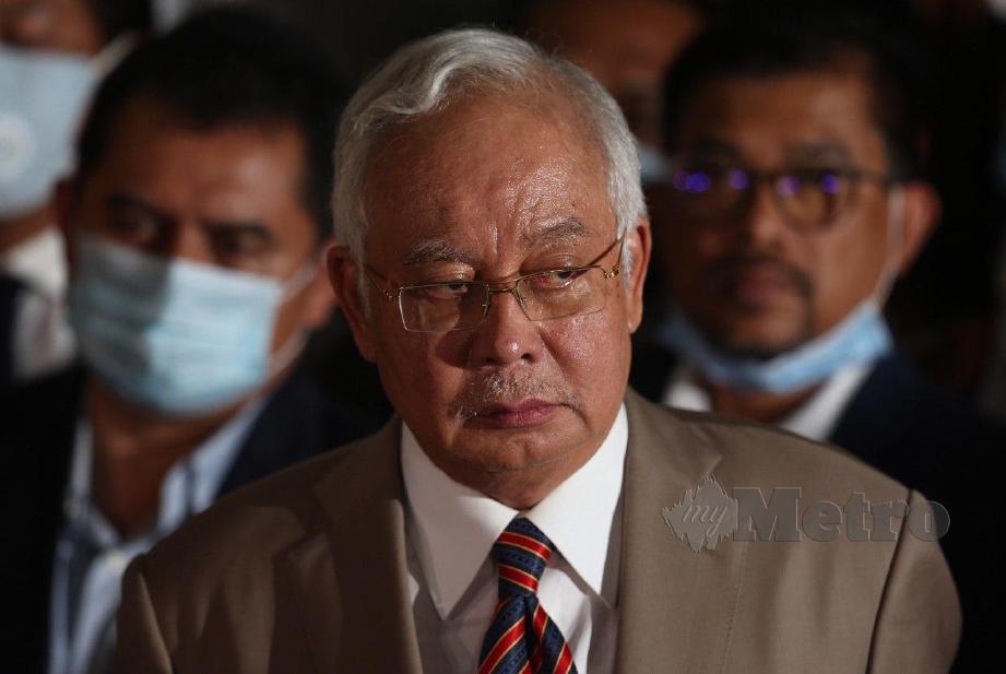 NAJIB meninggalkan mahkamah selepas didapati bersalah terhadap tujuh pertuduhan membabitkan pecah amanah jenayah (CBT), pengubahan wang haram dan menyalahgunakan kuasa membabitkan RM42 juta dana SRC International Sdn Bhd. FOTO Mohamad Shahril Badri Saali