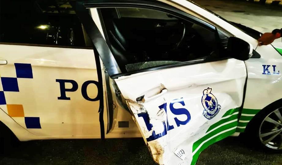 KEADAAN kereta peronda polis yang dilanggar penjenayah.