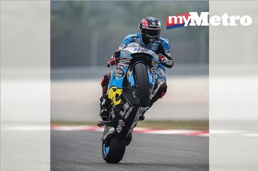 PELUMBA MotoGP pasukan Estrella Galicia 0,0 Marc VDS, Scott Redding melakukan `willie' selepas tamat sesi ujian masa bebas kedua di Litar Antarabangsa Sepang. FOTO Osman Adnan