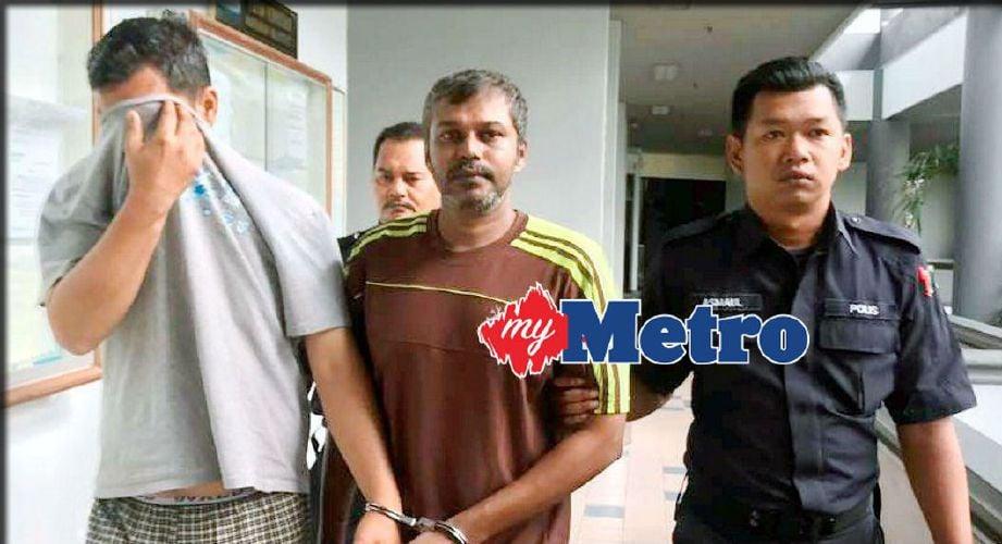 M Gunalan diiringi anggota polis keluar dari mahkamah selepas mengaku bersalah dan dijatuhi hukuman penjara enam bulan.