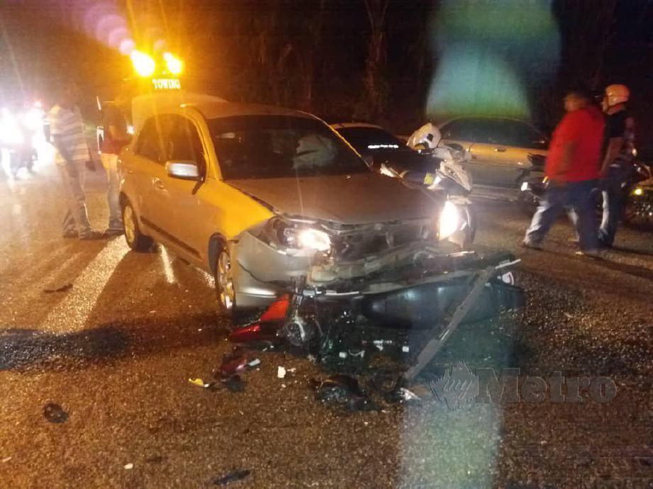 KEADAAN kemalangan di Kilometer 2, Jalan Tapah- Cameron Highlands, Tapah, yang meragut nyawa dua remaja lelaki. FOTO Ihsan PDRM
