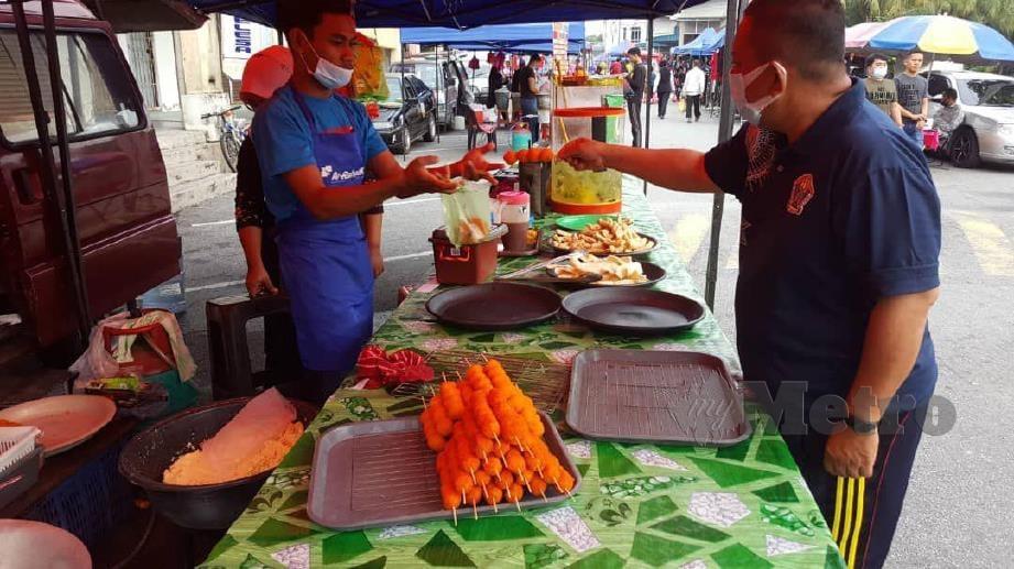 Peniaga yakin sambutan Pasar Malam di Sungai Udang bakal lebih agresif minggu ini. FOTO NAZRI ABU BAKAR