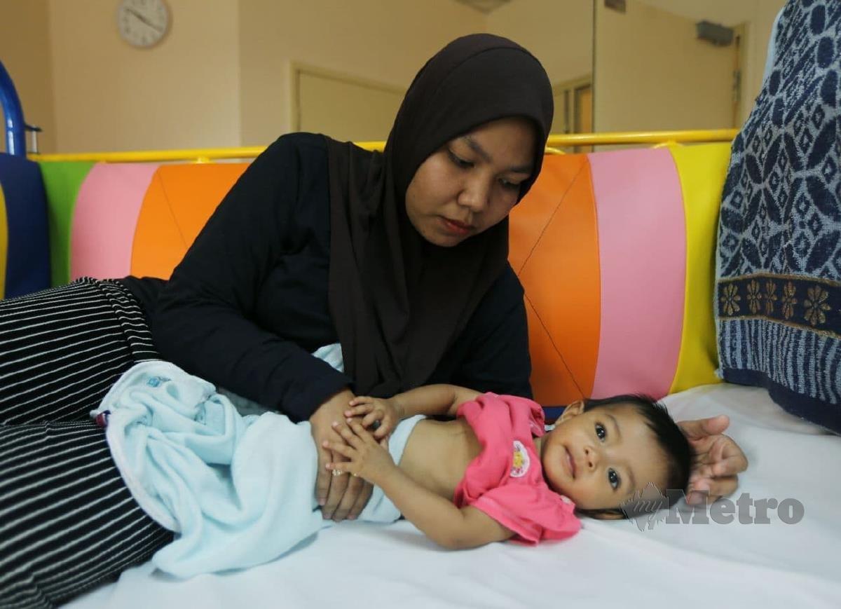 Aafiyah Husna memerlukan sumbangan RM 50,000, pembedahan akan dilakukan di Sunway Medical Centre. FOTO ROHANIS SHUKRI.