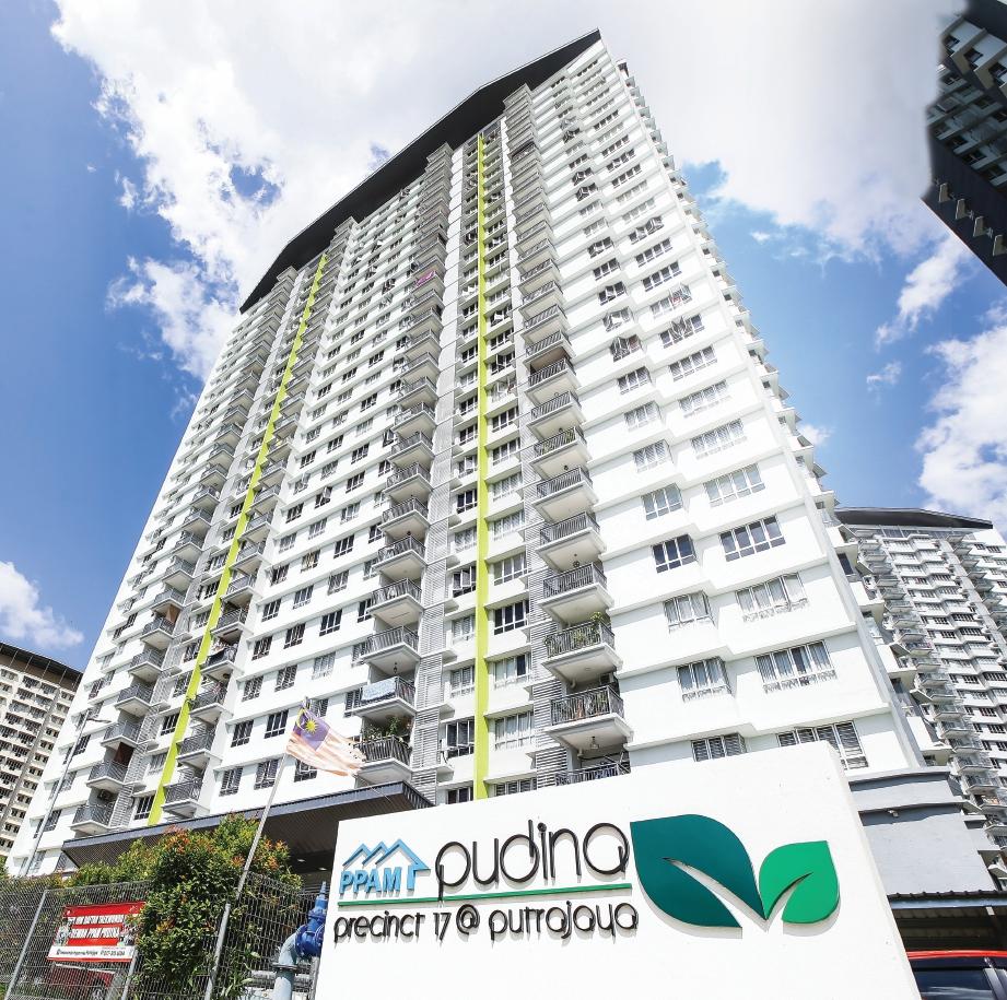 PEMBANTU tadbir miliki pangsapuri di lokasi strategik dengan panorama indah Putrajaya. FOTO Lokman Hakim Zubir