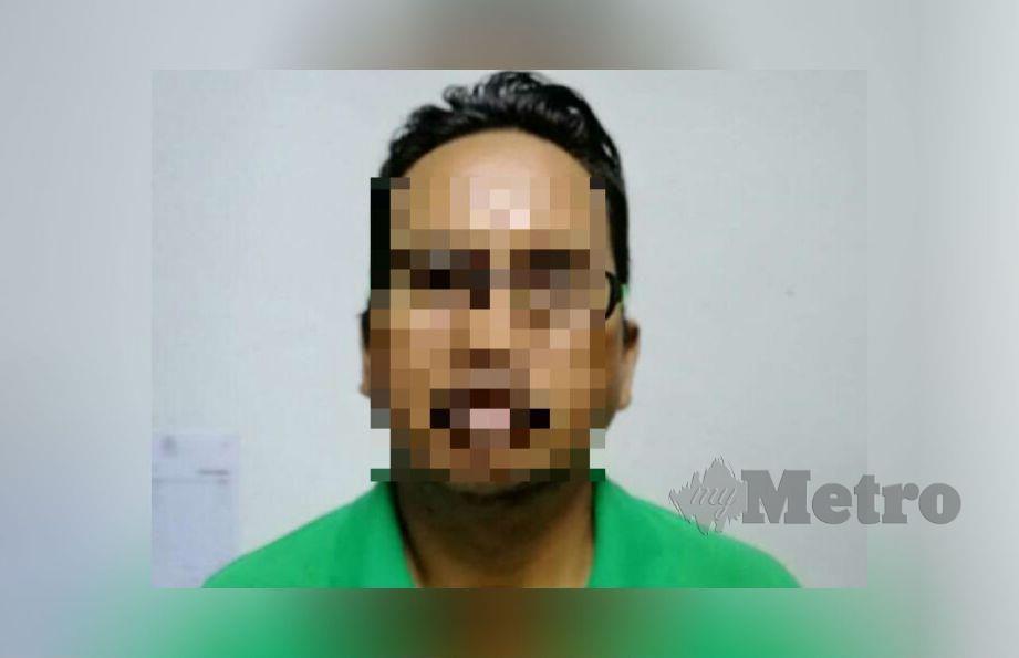 Suspek yang diberkas polis selepas membelasah isteri dan anaknya. Gambar Ihsan Polis.