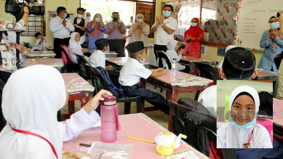 Radzi ketika melawat SK Sangkabok dekat Kuala Penyu. (Gambar kecil) Nur Husna Rasyidah Ridhwan. Foto Malai Rosmah Tuah