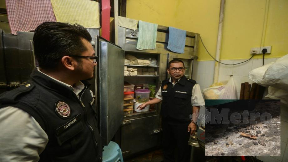 WAN Mansor (kanan) membuat pemeriksaan pada sebuah restoran di Lebuh Campbell , Georgetown. (Gambar kecil) Najis tikus ditemui di lantai dapur. FOTO Shahnaz Fazlie Shahrizal